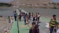 Displaced Iraqi families from the Yazidi community were crossing on Monday the Iraqi Syrian border at the Fishkhabur crossing in northern Iraq