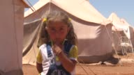 Displaced Syrians who fled besieged Homs within the Turkeybacked Operation Euphrates Shield suffer from the hot weather at Zoghara camp as...