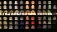 A display of coloured men's shirts and ties sit on shelves inside Hugo Boss AG's store on Regent Street in London PAN RL interior of the men's...