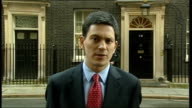 Dispute over British Council cultural offices ENGLAND London Downing Street EXT David Miliband MP along towards press David Miliband MP speaking to...