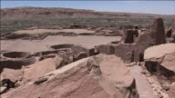 Distant buttes surround the ruins of Chaco Culture National Historical Park.