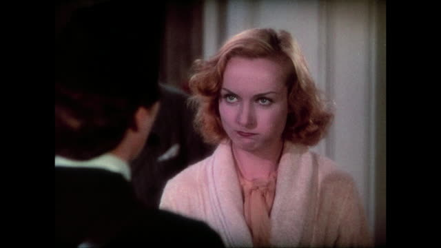 Distressed mayor (Charles Richman) becomes flustered after woman (Carole Lombard) admits fakery to him and others affected by her lie