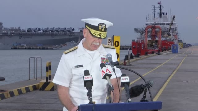 Divers searching for 10 missing sailors on a US destroyer that collided with a tanker off Singapore have found human remains a US admiral said Tuesday