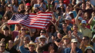 HA WS Diverse crowd cheering and holding American flag in bleachers / Homestead, FL, USA