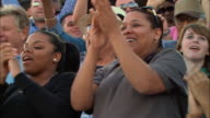 LA CU Diverse crowd clapping and cheering in bleachers / Homestead, FL, USA