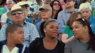 LA MS PAN Diverse crowd talking and watching in bleachers / Homestead, FL, USA