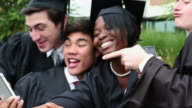 MS Diverse Group of High School Graduates Celebrating, Taking Self Portrait Photographs / Richmond, Virginia, United States