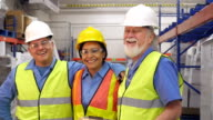 Diverse group of shipping & distribution warehouse employees smiling together