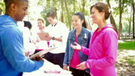 Diverse participants registering for breast cancer awareness race