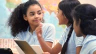 Diverse private STEM middle school students work on project together