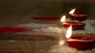 Diwali is the largest and brightest ancient festival of Hindus/ People dress up light up diyas or candles make rangolis participate in puja typically...