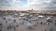 WS POV T/L Djemaa el-Fna square crowded with people and tourist doing shopping  / Marrakech, Morocco