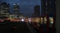 Docklands Light Railway trains at night in London UK on Monday Aug 7 2017
