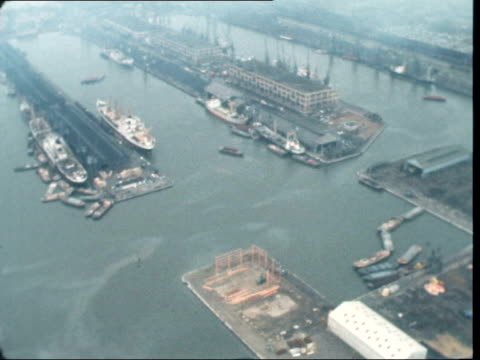 London Tilbury Docks Air view London dock Pan water to OCL crates MS OCL crates TILT crane to OCL crates TS as lifter crane come down to OCL crates...