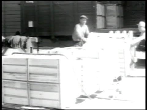 FINLAND Dockworker unloading crates Stern ship HELSINKI Aerial Helsinki shore HA street scene Tram passing