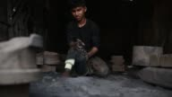 Dockyard workers making propeller using their own system near the Buriganga River in Dhaka on August 20 2017 There are more than 35 shipyards in Old...