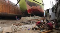Dockyard workers works near the Buriganga River in Dhaka on August 20 2017 / There are more than 35 shipyards in Old Dhaka's Keraniganj area in the...