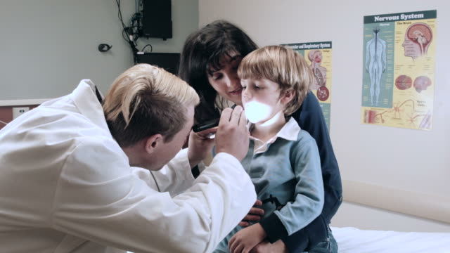 Doctor Checking Little Boy