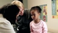 Doctor Checking Little Girl