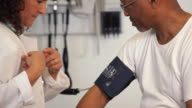 'CU doctor checking the blood pressure of senior patient/Richmond,Virginia, USA'