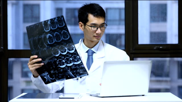 Doctor checking x-ray photo of patients