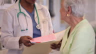 MS Doctor Discussing Medical Records with Senior Patient / Richmond, Virginia, USA