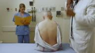 MS Doctor examining patient in hospital room / Edmonds, Washington, USA