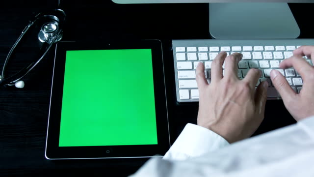 Doctor hands working with digital tablet ,Chroma key.