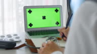 Doctor Laptop Computer with Green Screen