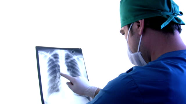 Doctor looks at x-rays