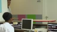 MS Doctor passing file to nurse at nurses station / Helmond, North Brabant, Netherlands