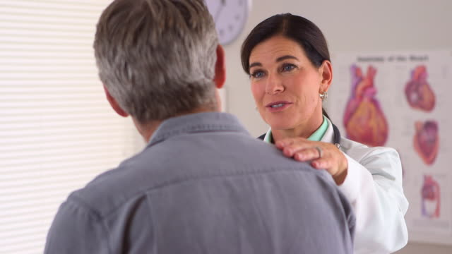Doctor reassuring her patient's quick recovery