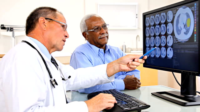 Doctor Reviewing Test Results With Patient