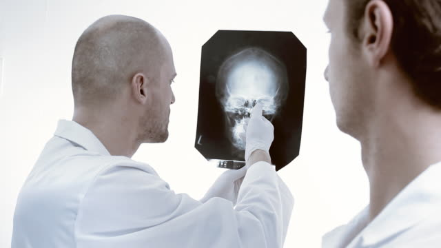 Doctor reviews x-ray