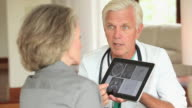 MS Doctor showing patient test results on digital tablet / Richmond, Virginia, USA