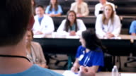 Doctor speaking to group of hospital staff during healthcare conference