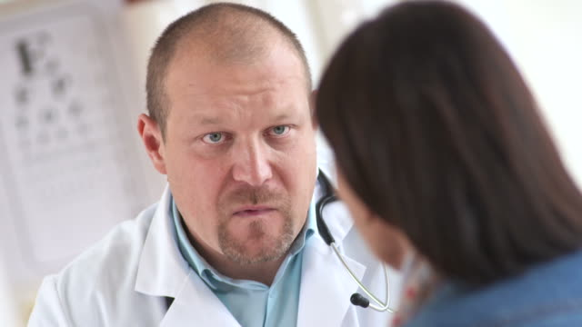 HD: Doctor Talking With Female Patient