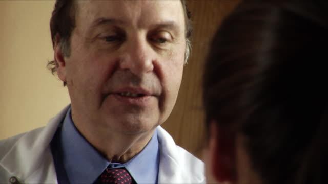 CU Doctor talking with patient / Burlington, Vermont, USA