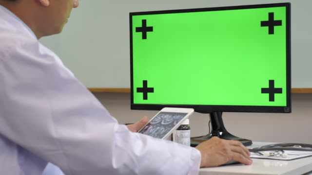 Doctor using Computer with Chroma key
