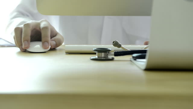 Doctor using computer with stethoscope