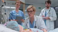 DS Doctor visitingher child patient in the intensive care