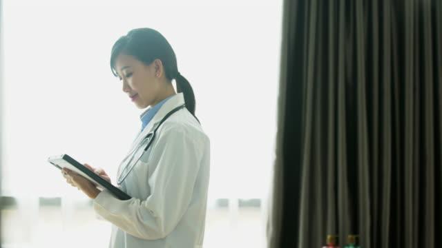 PAN doctor walking through hospital