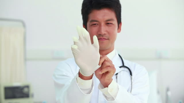 Doctor wearing a latex glove