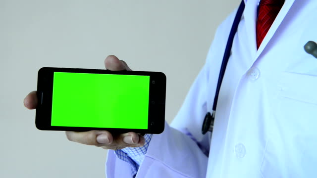 Doctor with green screen mobile device