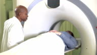 Doctor with patient getting CAT scan
