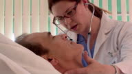 Doctor with patient in hospital