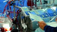 Doctor writes down Cardiopulmonary bypass machine data