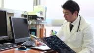 MS Doctor writing memo / Shibuya, Tokyo, Japan