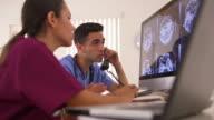 doctors analyzing brain x-rays