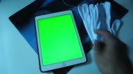 Doctors Examining X-Ray Image On A Tablet green screen.